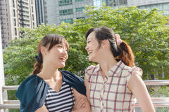 Asian woman with friends Stock Images