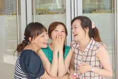 Asian woman with friends Stock Photo