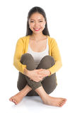 Asian woman full body seated Royalty Free Stock Images