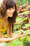 Asian Woman in the garden Stock Image