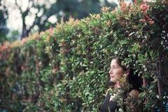 Asian Woman in the Garden Stock Photo