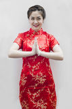 Asian woman with gesture of congratulation. Happy Chinese new year. beautiful young Asian woman with gesture of congratulation Royalty Free Stock Image