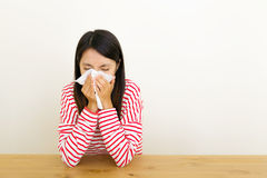 Asian woman get cold. At home Royalty Free Stock Photography