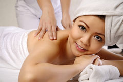 Asian Woman Get Massage On The Spa Stock Images