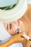 Asian woman getting a facial treatment in spa Royalty Free Stock Photo