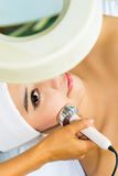 Asian woman getting a facial treatment in spa Royalty Free Stock Photos