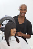 Asian woman getting herself groomed at hair salon Stock Image