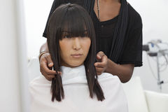 Asian woman getting a new haircut at beauty salon Royalty Free Stock Image