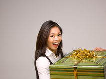 An Asian woman and a gift Stock Images