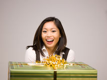 An Asian woman and a gift Royalty Free Stock Photography