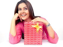 Asian woman with a gift box. Beautiful young asian woman with a gift box Royalty Free Stock Images