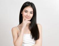 Asian woman girl beauty portrait. Studio shot. Gray background Royalty Free Stock Photography