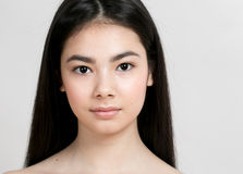 Asian woman girl beauty portrait. Studio shot. Gray background Stock Images