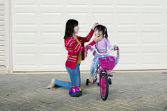Asian woman giving support on her daughter Royalty Free Stock Images