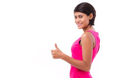Asian woman giving thumb up gesture, side view Royalty Free Stock Photos