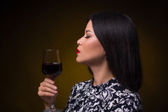 Asian woman with glass of red wine Stock Image
