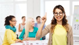Asian woman in glasses or student with finger up. Creative people, occupation and education concept - happy asian women or student in glasses fixed by tape royalty free stock image