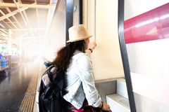 Asian woman going to travel by train stock photography