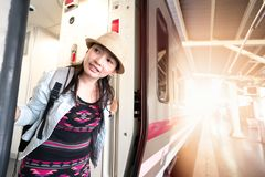 Asian woman going to travel by train royalty free stock photo