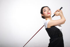 Asian woman golfing. Isolated on white stock photo