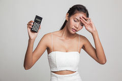 Asian woman got  headache with calculator. Stock Images