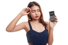 Asian woman got  headache with calculator. Royalty Free Stock Photos