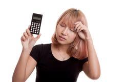 Asian woman got  headache with calculator. Stock Photos