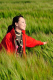 Asian woman grass in red Stock Photos