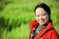 Asian woman grass in red Stock Photography
