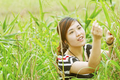 Asian woman in the grasses Royalty Free Stock Images