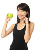 Asian woman with green apple and toothy smile. Isolated on white background Stock Photo