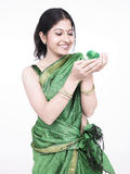 Asian woman with a green chick Royalty Free Stock Photos