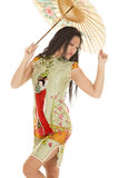Asian woman green dress umbrella look back Royalty Free Stock Photo
