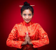 Asian woman greets Royalty Free Stock Photography