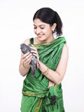 Asian woman with a grey dove Stock Photo