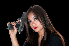 Asian woman with gun Stock Images