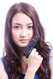Asian woman with the gun on her hand Stock Images