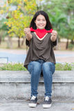 Asian woman hand hold beautiful red heart sweet loving symbol Stock Photo