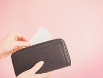 Asian woman hand hold and insert credit card in her blue purse w Stock Photo