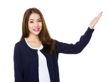 Asian woman with hand showing blank sign Stock Photos