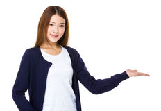 Asian woman with hand showing blank space Stock Images
