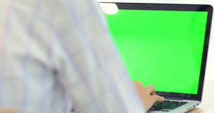 Asian woman hand typing on Laptop with green screen. Asian woman hand is typing on Laptop with green screen stock video footage