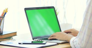 Asian woman hand typing on laptop with green screen. Asian woman hand is typing on laptop with green screen stock video