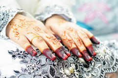 Asian woman hands with henna. Selective focus and shallow depth of field Stock Photos