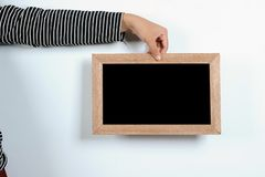 Asian woman hands holding blackboard stock image