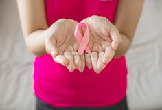 Asian woman hands holding pink ribbon,Breast cancer awareness concept. Asian women hands holding pink ribbon,Breast cancer awareness concept royalty free stock photo