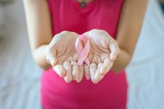 Asian woman hands holding pink ribbon,Breast cancer awareness concept,Close up. Asian women hands holding pink ribbon,Breast cancer awareness concept,Close up royalty free stock image