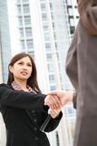 Asian Woman Handshake Stock Image