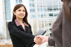 Free Asian Woman Handshake Royalty Free Stock Images - 5067869