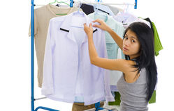 Asian woman hanging clothes Stock Photo